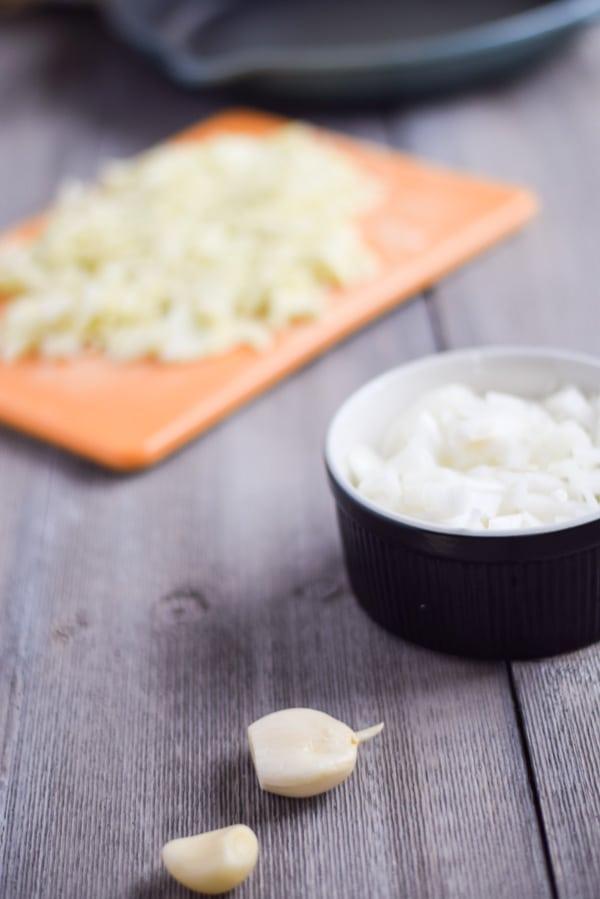 garlic, onions and chopped zucchini for the Gouda Stuffed Zucchini Boats