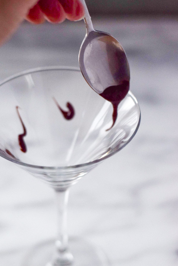 Nutella dribbled into martini glass for chocolate martini
