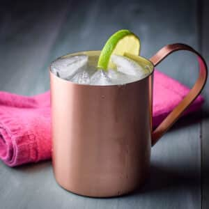 A square photo of a copper mug filled with a Moscow mule