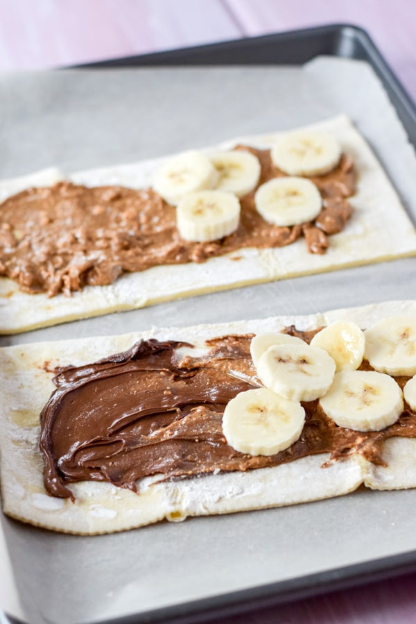 Bananas on the Nutella and almond butter for the puff pastry sheets