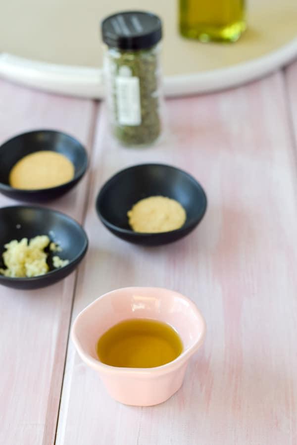 Olive oil, onion powder, garlic powder, garlic and tarragon for thee Very Delicious Roasted Herb Cauliflower