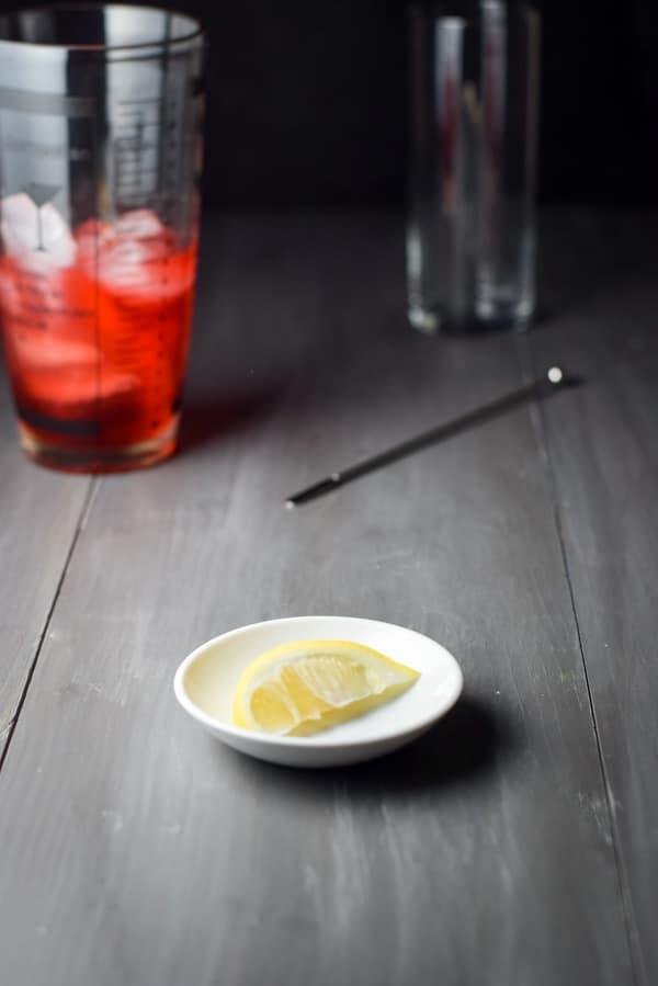 Lemon wedge cut for the sloe gin fizz cocktail