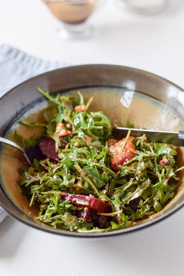 Cut up awesome colorful arugula beet salad