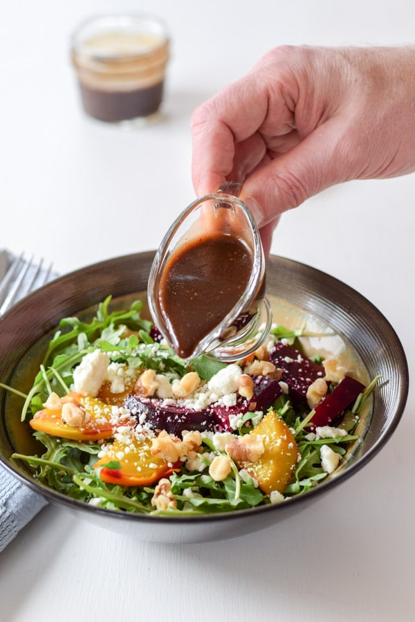 Ready to pour the dressing on the awesome colorful arugula beet salad