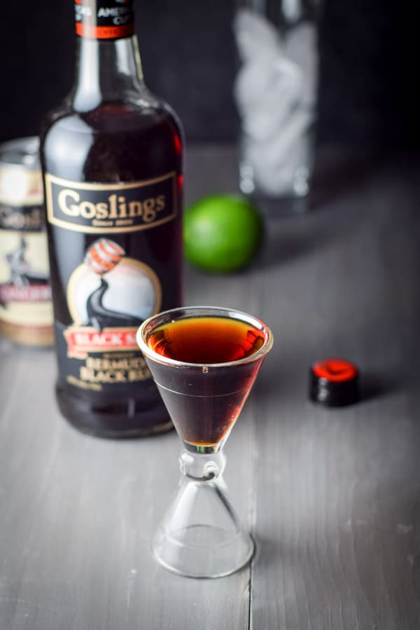 Gosling red seal rum poured out for the exotic delicious dark and stormy cocktail
