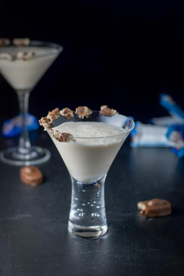 Almond joy cocktail with the candy on the rim of a short glass