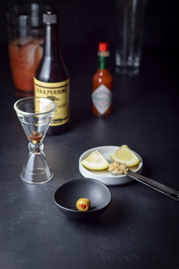 An olive, spices, horseradish and sauces in the refreshingly delicious Bloody Mary Cocktail