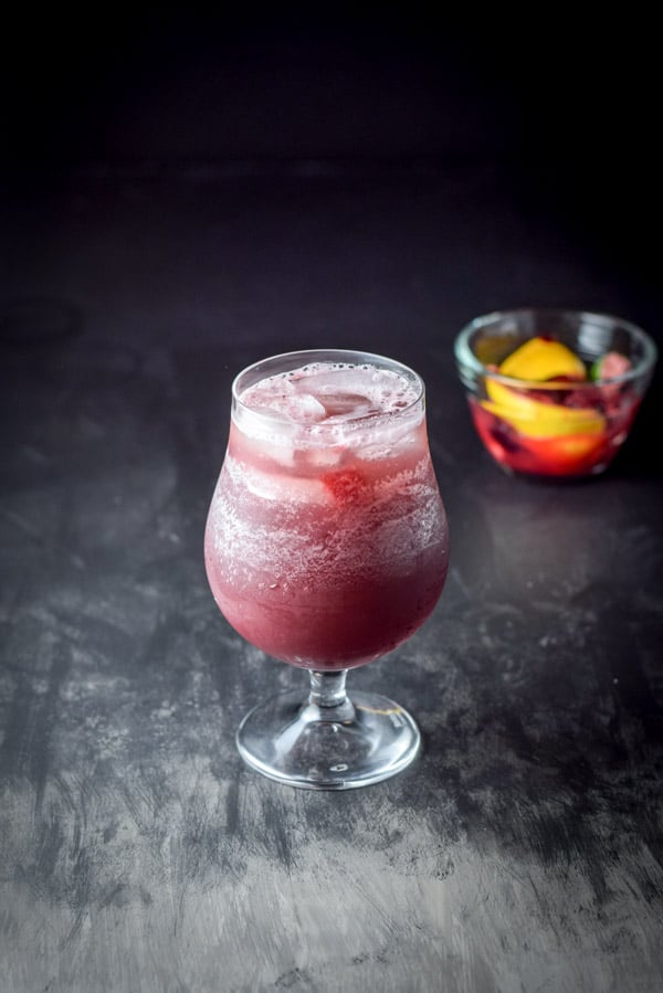 Club soda poured into the scintillatingly satisfying sangria cocktail