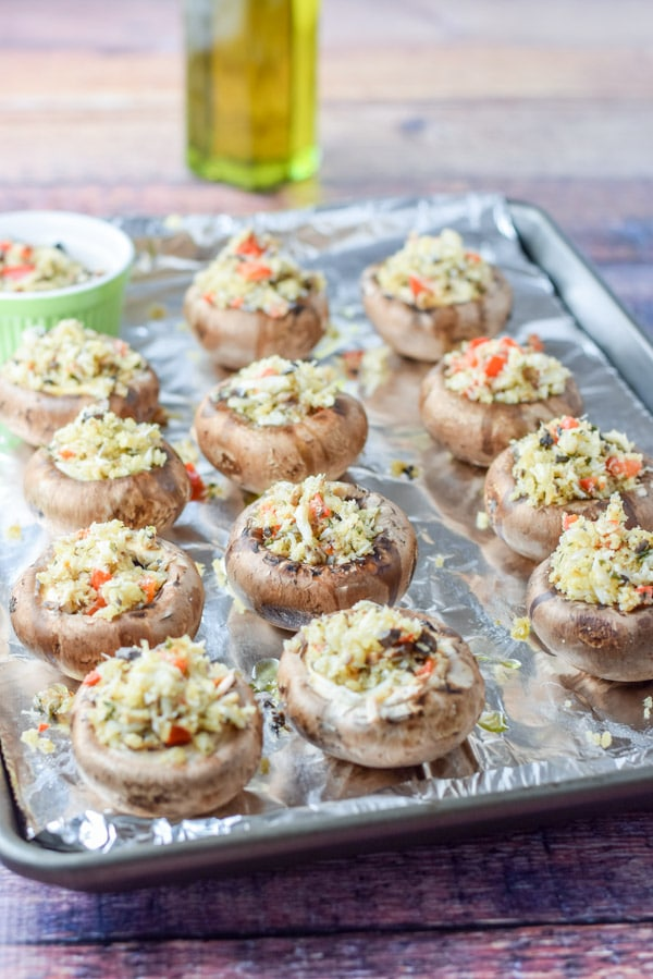 Crazy Good Savory Crab Stuffed Mushrooms drizzled with oil and ready to be baked
