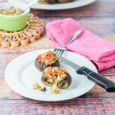 Crazy good savory crab stuffed mushrooms plated and ready to be eaten