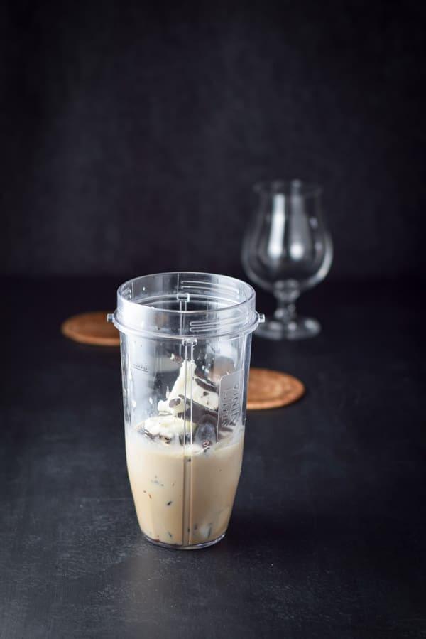 Yogurt into the blender for Nancy's Indulgent Delicious Frozen Mudslide Cocktail