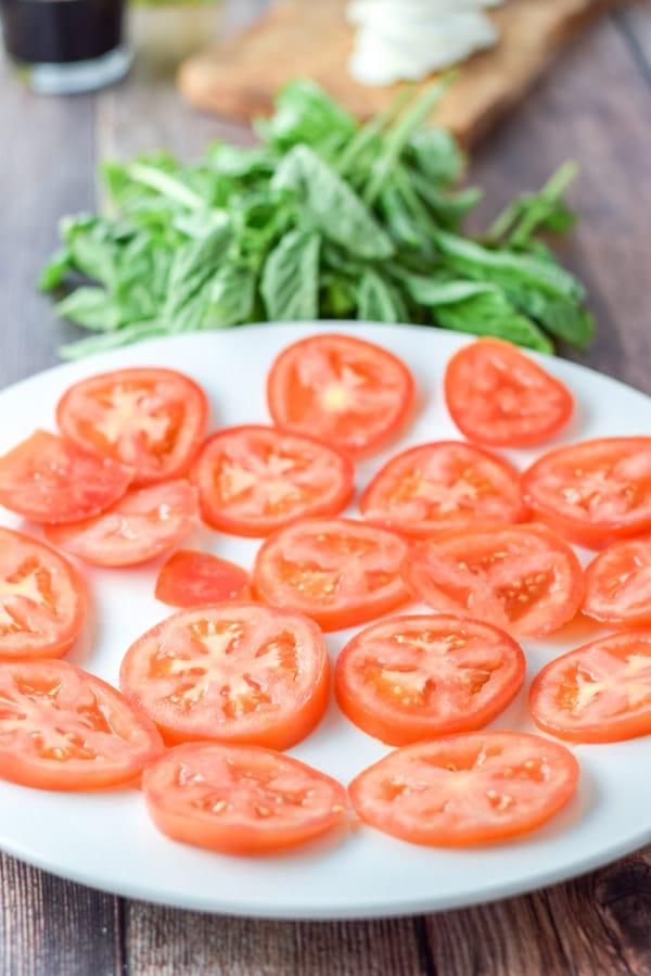Tomatoes all cut and ready to be made into Scrumptious Caprese salad