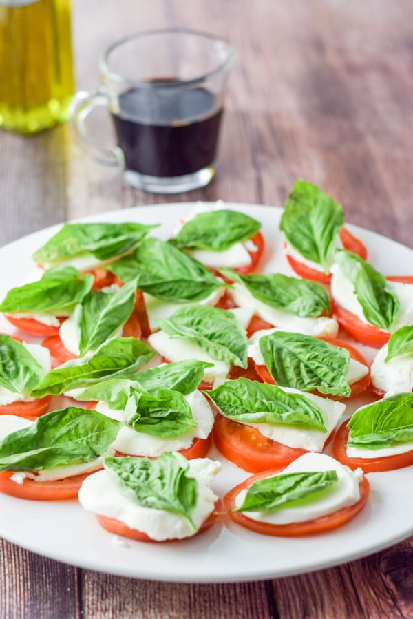 Basil topped on the mozzarella for the scrumptious and easy caprese salad