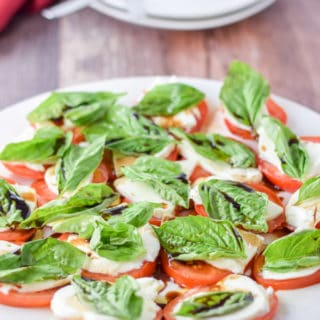 Plated scrumptious and easy caprese salad ready to be eaten