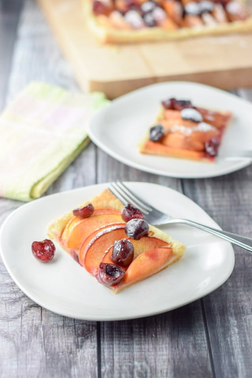 A yummy cherry and peach tart ready to be eaten