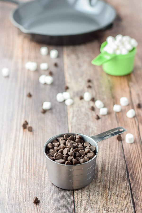 Chocolate chips and marshmallows for the toasted marshmallow chocolate chip skillet cookie