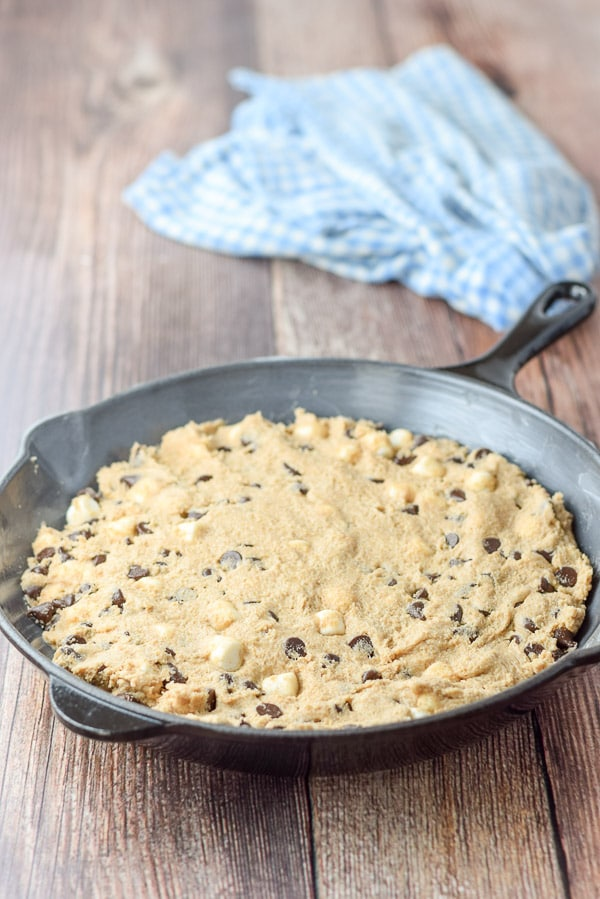 Batter pressed in the pan for the toasted marshmallow chocolate chip skillet cookie