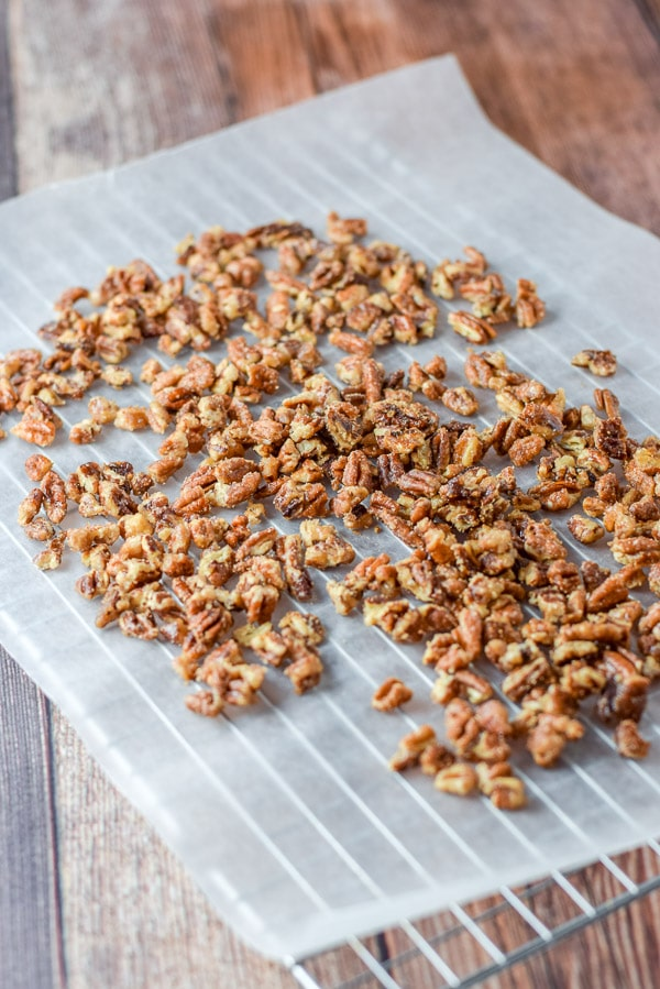 Pecans all cooked and laid out on some wax paper for the simple stovetop candied pecans