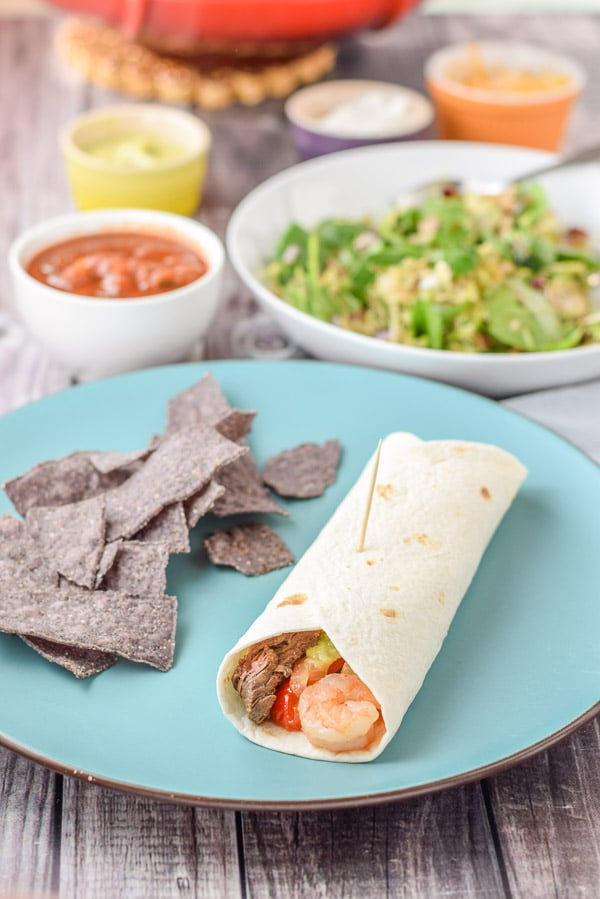 Rolled up scrumptious steak and shrimp fajita