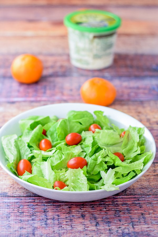 Grape tomatoes on the sweet orange scallop salad