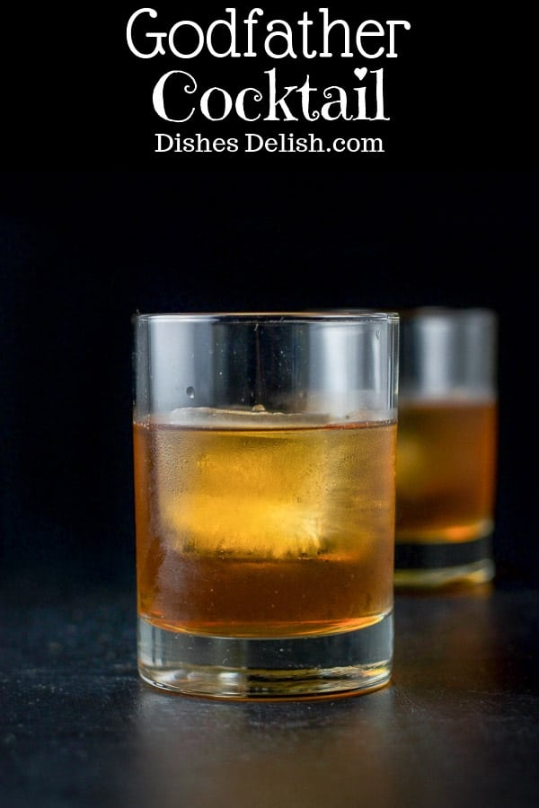 This godfather cocktail only has two ingredients in equal parts which makes it really easy to remember.  It's also so delicious!!  #godfathercocktail #cocktail #drinks #scotch #dishesdelish https://ddel.co/gfc