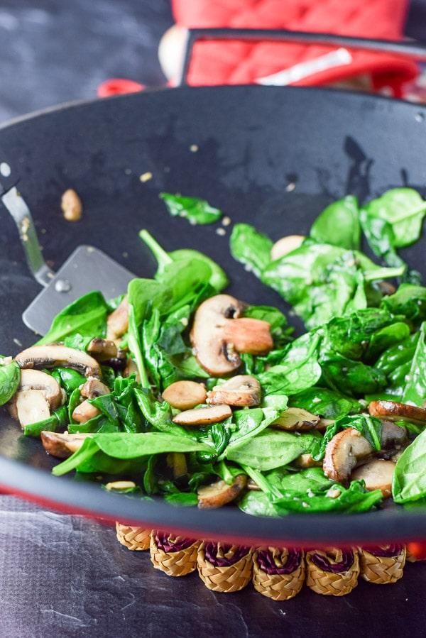 Spinach and mushroom sautéed for the spinach and mushroom fettuccini alfredo