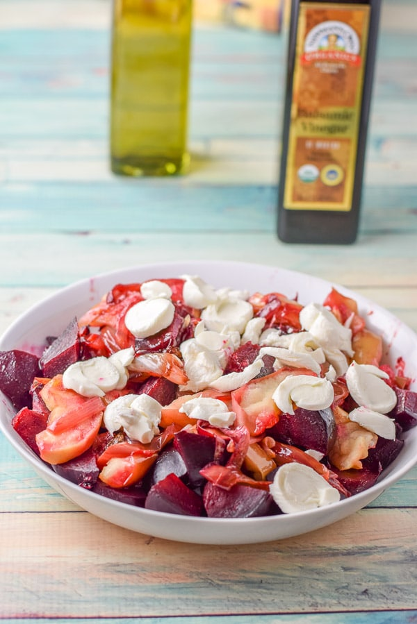 Mozzarella sliced and placed on the versatile apple and beet salad
