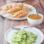 Thai cucumber salad served with some chicken satay and peanut sauce