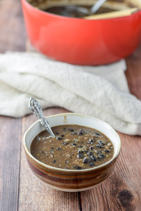 Bowl of bold black bean soup served and ready to eat