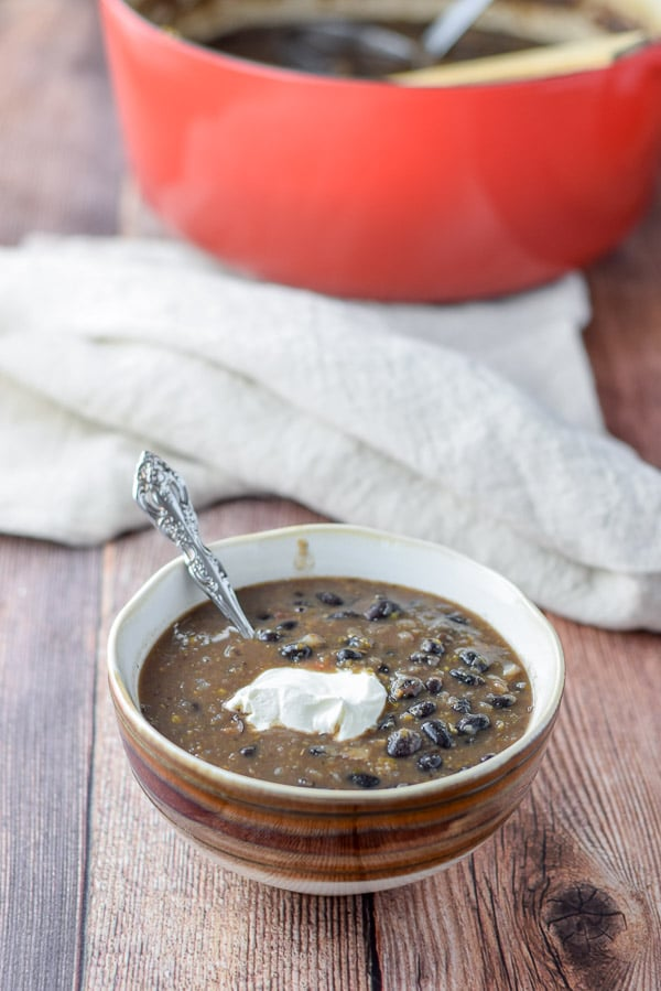 Sour cream in the bold black bean soup
