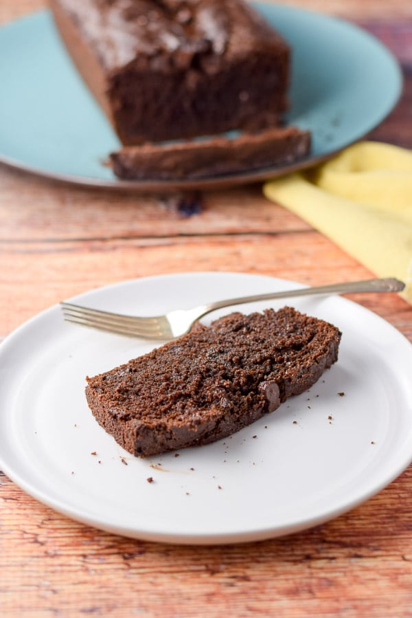 A slice of chocolate chocolate chip bread plated