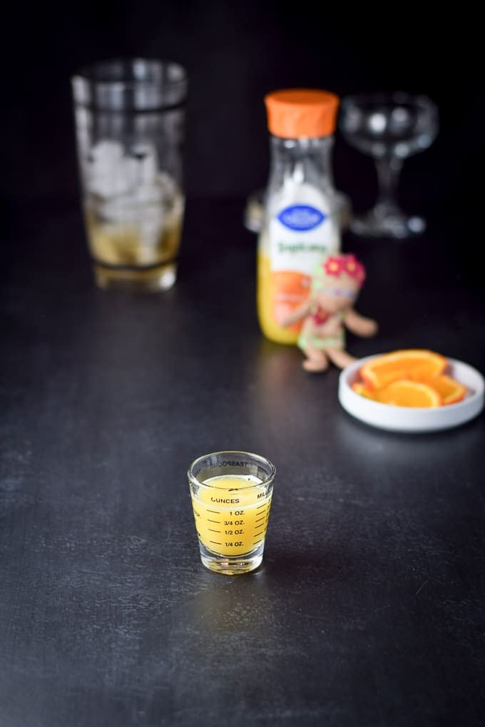 Orange juice in the shot glass for the destination paradise cocktail