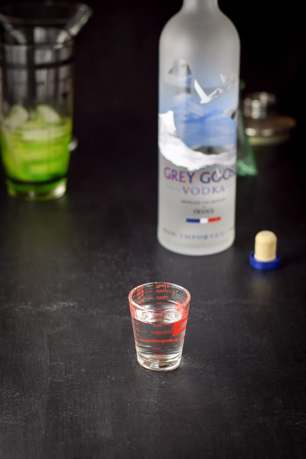 grey goose vodka poured out for the magnificent melon ball cocktail