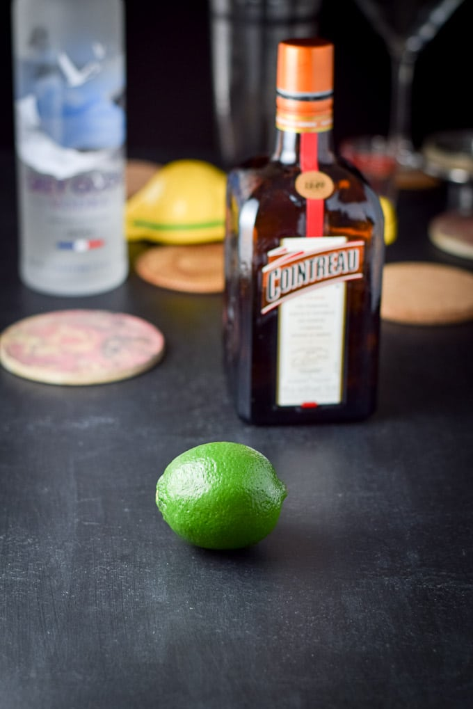 Ingredients for my sister's kamikaze cocktail. Lime, cointreau, vodka and the shaker