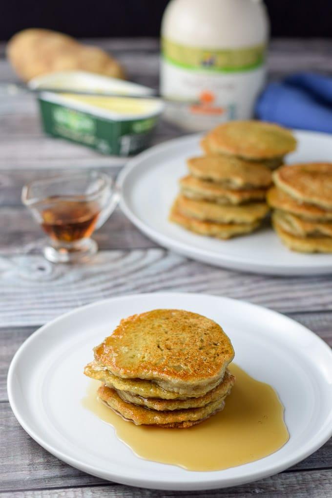 Maple syrup poured on Nana's Potato Pancakes