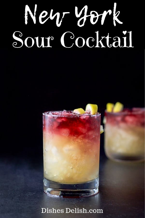 This Bourbon New York Sour Cocktail is pretty as a picture.  But it's not just about looks,  the drink is super delicious! #bourbon #newyorksour #cocktails #drinks #dishesdelishcocktail http://ddel.co/bnysckl