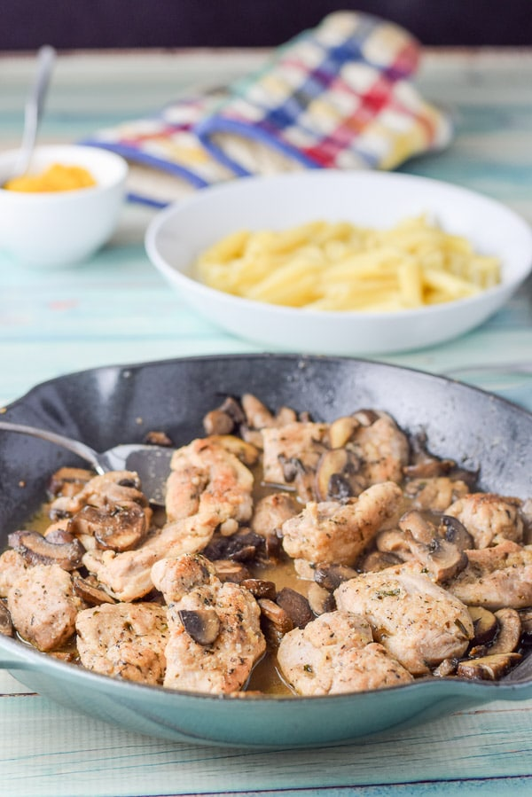 Chicken and mushrooms in the pan for the super easy chicken marsala