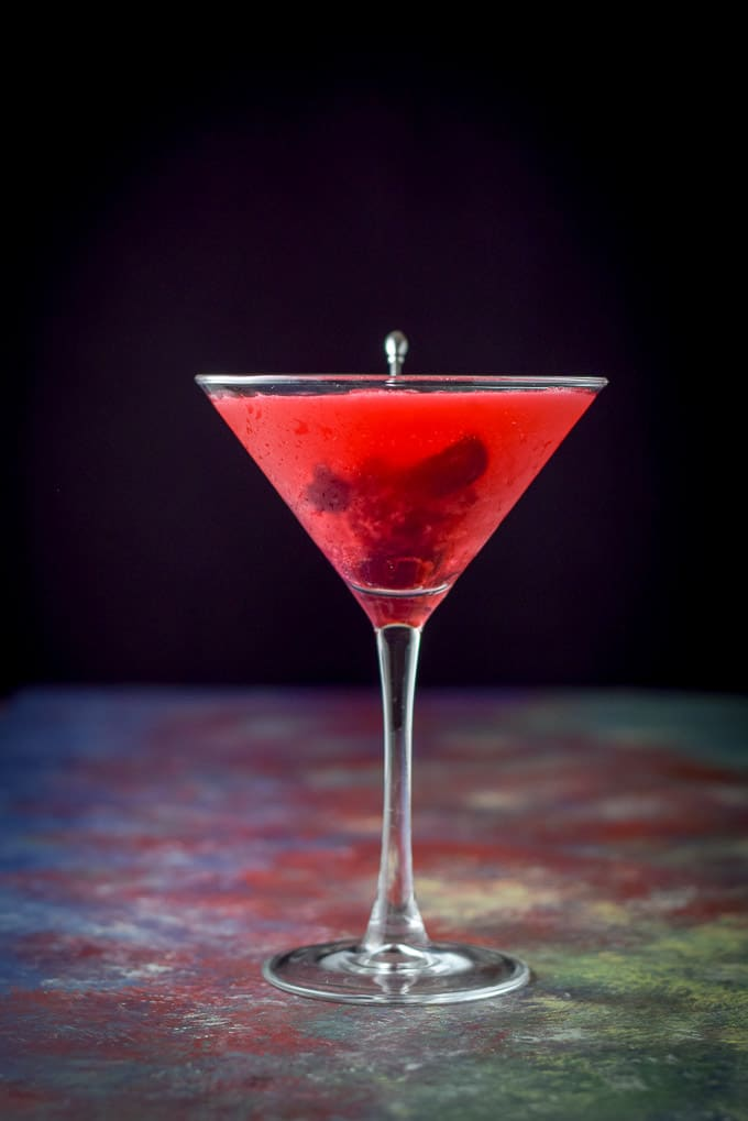 Vertical view of the bing cherry cosmo cocktail