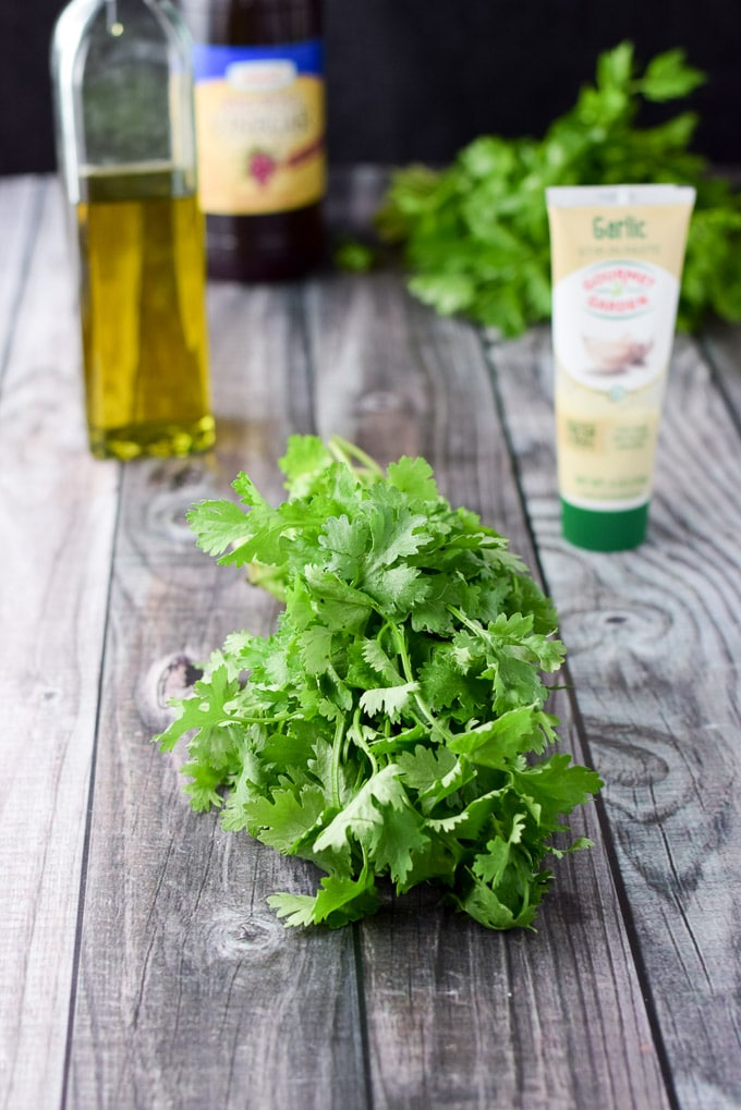 Cilantro, parsley, garlic paste, olive oil and balsamic vinegar for the shimmy for Chimichurri dressing