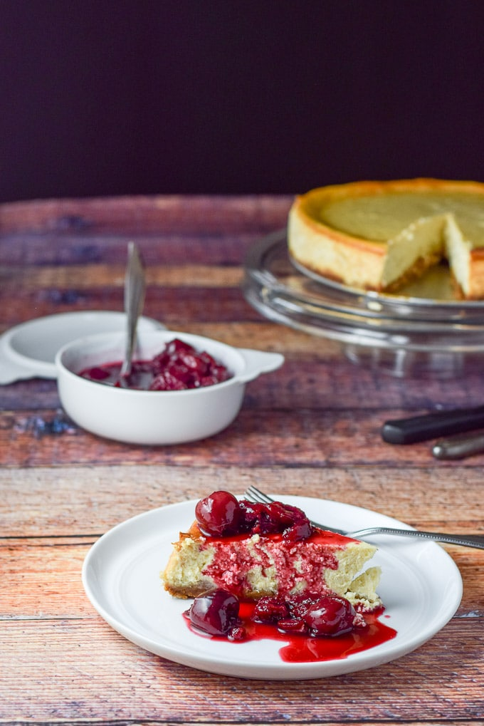 Cherry sauce poured on the classic New York cheesecake