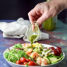 Chimichurri dressing poured for the Smorgasbord Shrimp Salad