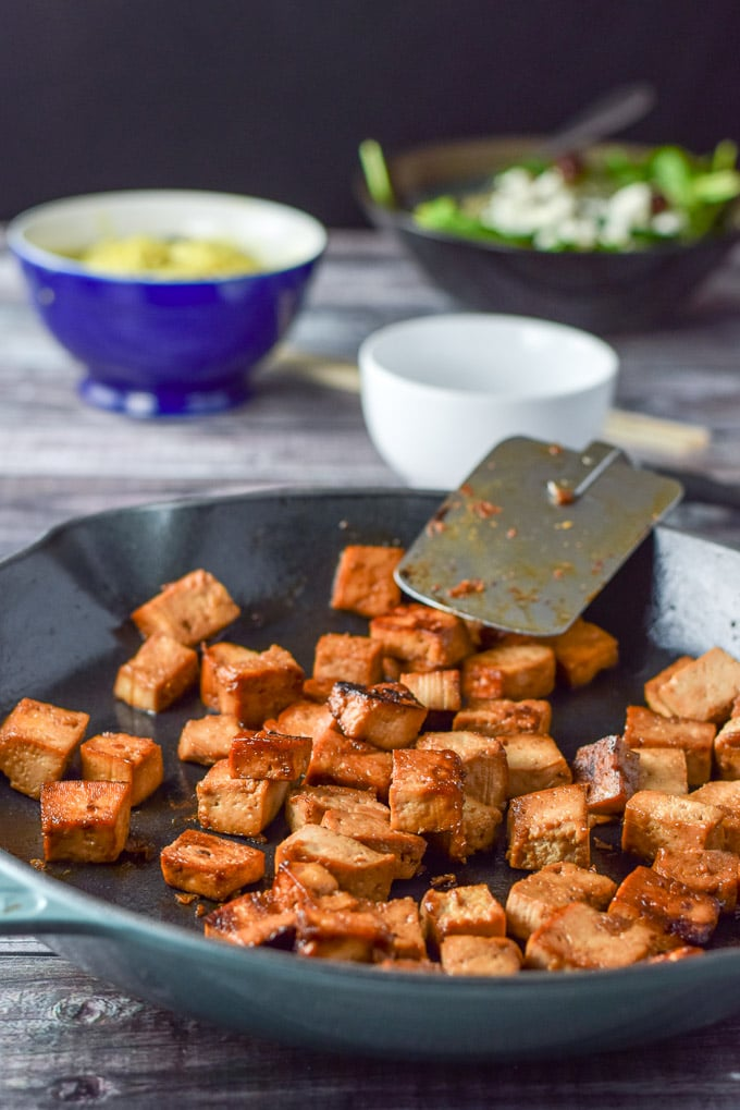 Sauteed soy maple tofu in a pan, done and ready to eat