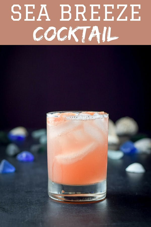 This sea breeze cocktail is a classic, at least for those of us who grew up in the 80's.  Delicious and easy to make.  You can either use grapefruit juice or orange juice.  You pick. #seabreeze #cocktail #drink #dishesdelish #dishesdelishcocktails http://ddel.co/ssbreeze
