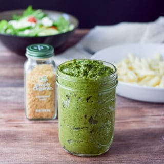 Versatile vegan pesto sauce shown in a jar