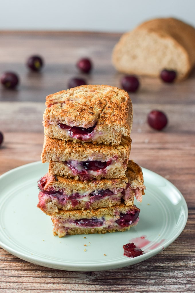 Pile of cherry camembert grilled cheese sandwich