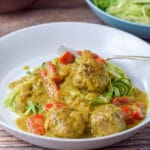 Plated curry meatballs on zoodles