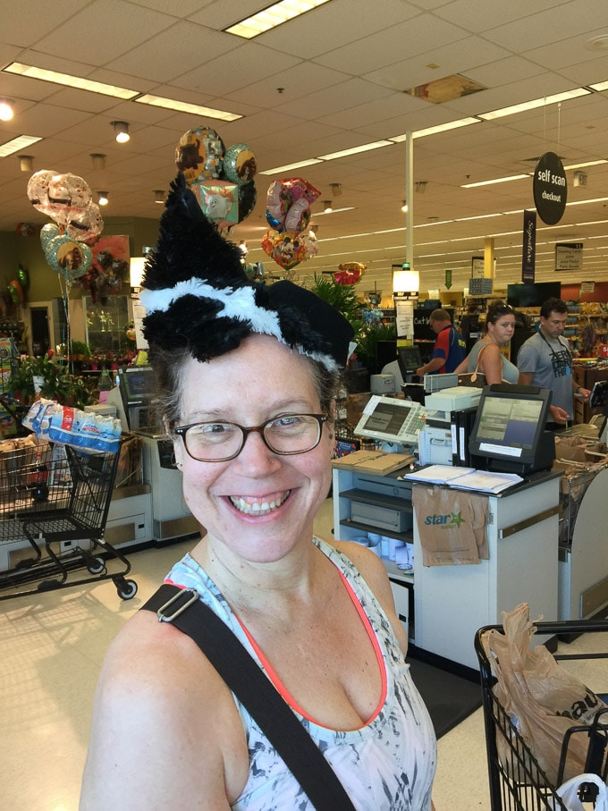Laineey with a skunk dog toy hat