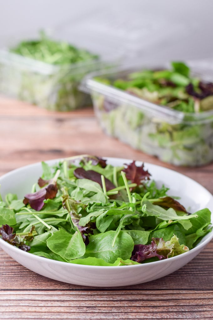 Baby romaine and arugula in a bowl for the yellow beet and fig salad