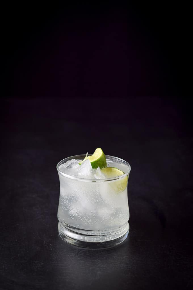 Dark shot of my brother Bob's basic gin and tonic cocktail