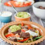 Guacamaole and sour cream dolloped on the steak fajita burrito bowl